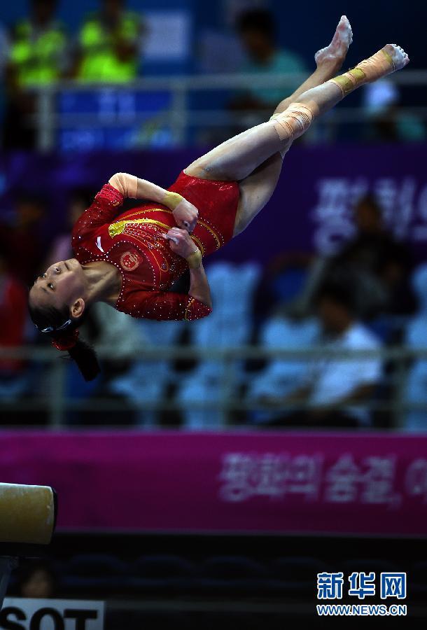 中国 韩瑜庆/9月22日,中国选手白雅雯在自由体操比赛中。当日,在2014仁川...