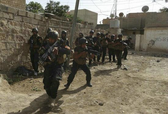 资料图:伊拉克安全部队特种部队在叙伊边境与极端武装势力展开激战.
