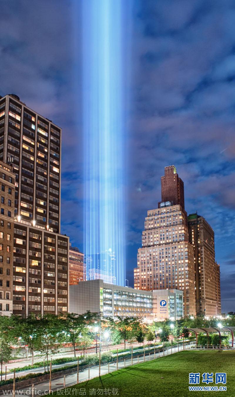 """世贸大厦倒塌原因_纽约世贸大厦首现""""自然光柱"""" 与""""911""""纪念光柱神似(组图 ..."""