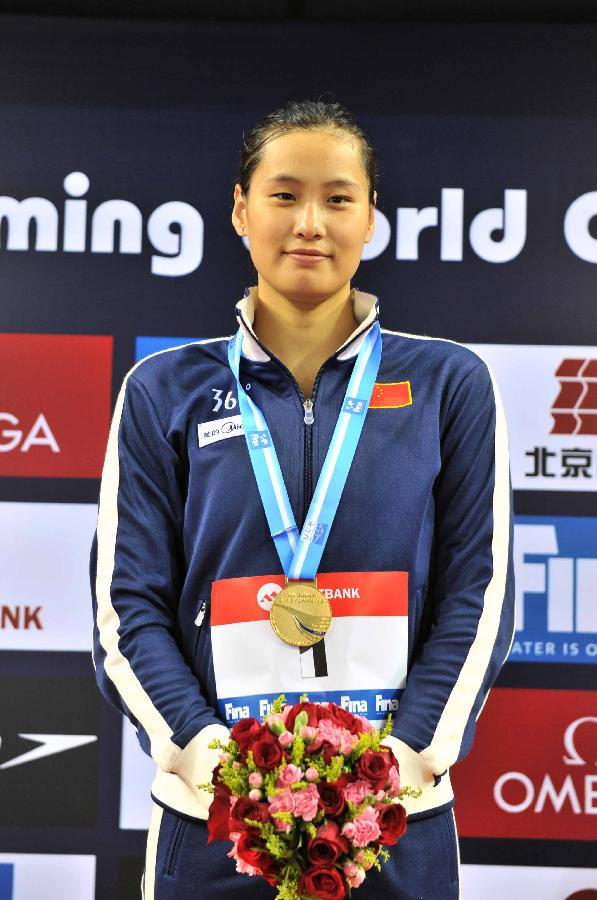 (体育)(1)游泳——短池游泳世界杯(北京站):陆滢夺女子100米蝶泳冠军
