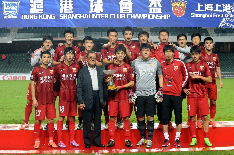 (初中)(1)冠军江门上港队获得上海杯足球赛足球(图)2017沪港排名体育图片