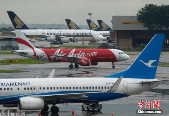 资料图:12月28日,亚洲航空一架从印尼泗水飞往新加坡的客机与地面控制塔台失去联系,机上载有162人。