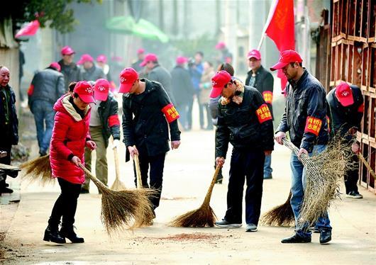 """图文:咱们村里的""""红帽""""们"""