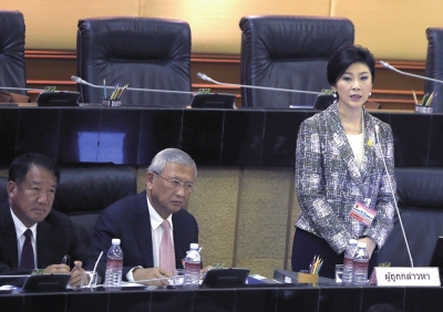 1月22日,泰国前总理英拉答复国度立法议会的发问。图/东方IC