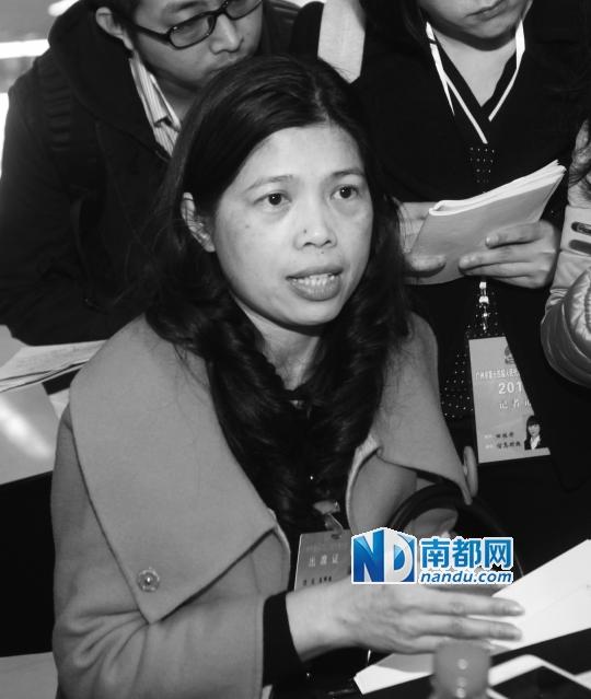 广州市人大代表庄伟燕追问停车费问题,让她成了焦点人物。南都记者冯宙锋摄