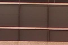 F1.4光圈能24mm F1.4(左)和适马24mm F1.4(右)样张100%放大截图