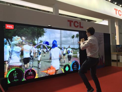 it数码新闻滚动_搜狐资讯    游戏区的人机互动游戏成为tcl展区的一