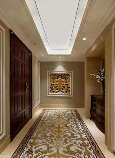 玄关设计效果图:大胆的采用图案的装饰,使单调的墙面富有了层次感