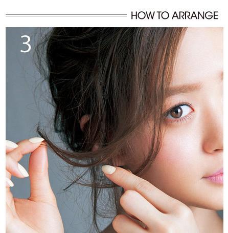 step2:用卷发棒烫卷前额的长发刘海.图片