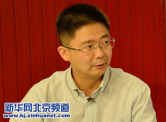 北京市医院管理局医疗护理处处长谷水在访谈现场。新华网北京频道发,骆璐摄