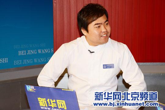 王博在访谈中。新华社北京频道发 洪轩