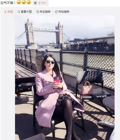 李湘晒_李湘晒美照 戴墨镜河边悠闲喝咖啡(图)