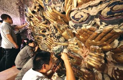 修复后的重庆大足石刻千手观音造像部分。新华社发