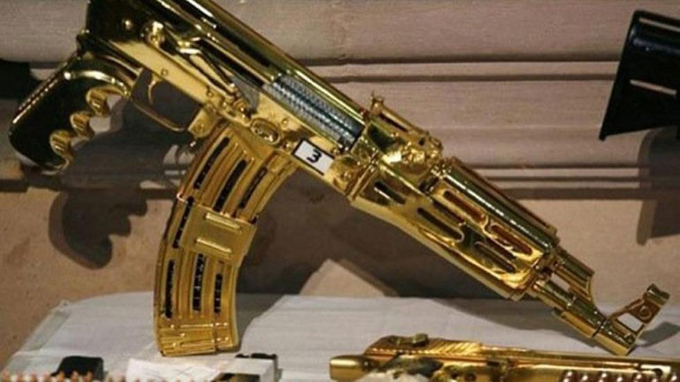 墨西哥毒枭古斯曼珍藏的黄金手枪网页截图)
