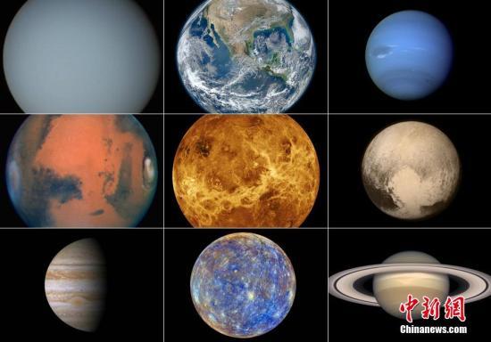 """资料图:7月14日,美国太空总署NASA冥王星探测器""""新视野号""""传回一批迄今最清晰的冥王星照片。至此,太阳系兄弟九个终于都有清晰的证件照。"""