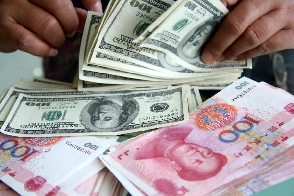 一纸声明引发了人民币汇率的大幅波动。CFP 资料