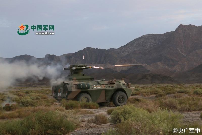 远程火箭炮实射击图片_印度怎么看解放军远程火箭炮高原射击场面十