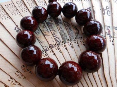 请问小叶紫檀的手串怎么就算包浆了,谢谢木材的包浆是木头中所渗出的