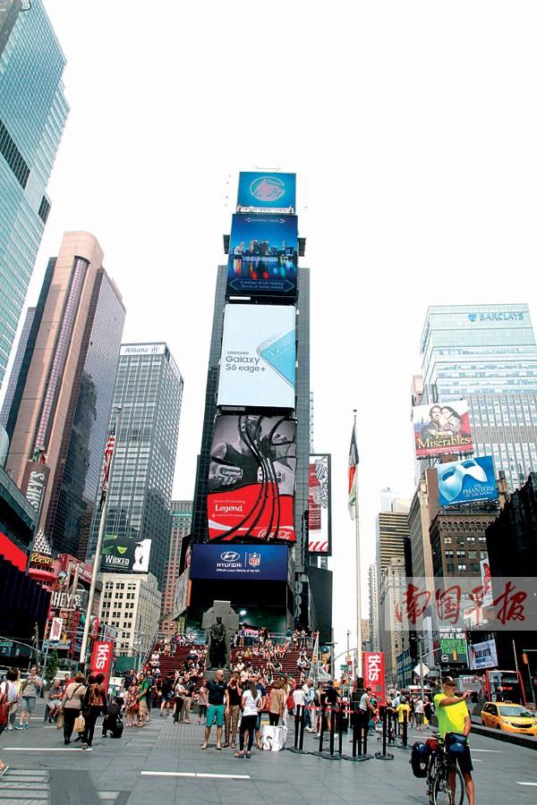 """南宁城市宣传片通过纽约时报广场""""中国屏""""展示南宁景点风光以及民族文化等。南宁市委宣传部供图"""