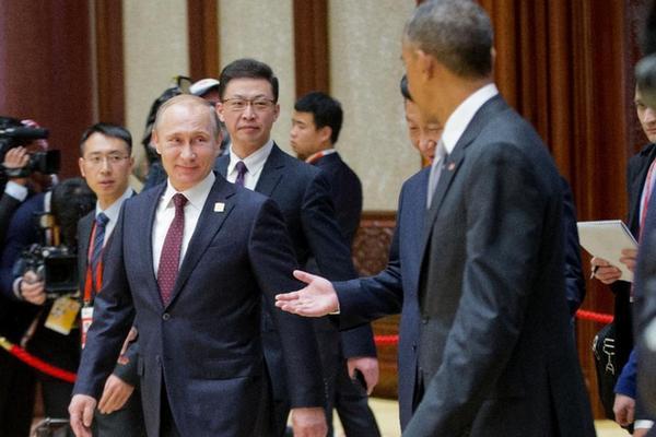 俄罗斯总统普京(左)与美国总统奥巴马(右)材料图。(图像来历:法新社)