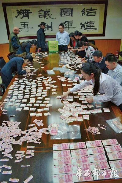 银行连续加8天夜班,完成碎钞拼接工作
