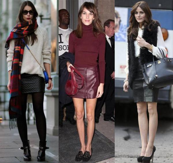 麝皮的半身裙,搭配针织衫和皮衣,将衣服扎进裙子里,一双短靴凹造型图片