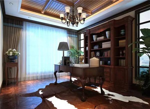 作为整套居室中最安静的空间,优雅沉稳的书桌和书柜搭配拼花木地板图片