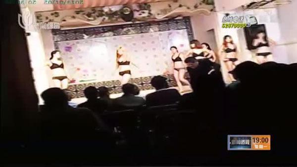 图说:上海电视台暗访视频截图,松江区仓汇路418号里面的表演露骨。