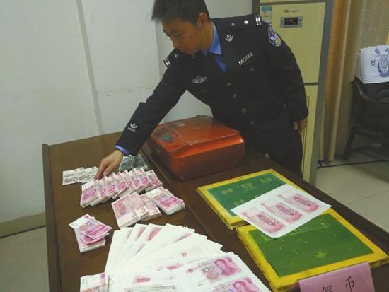 警方查获的假币,以及高清打印机、切纸刀等作案工具。