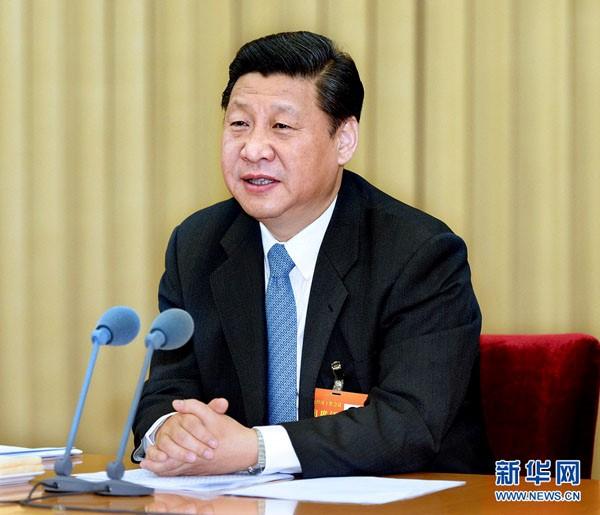 2013年12月10日至13日,中央经济工作会议在北京举行。中共中央总书记、国家主席、中央军委主席习近平发表重要讲话。新华社记者李涛摄