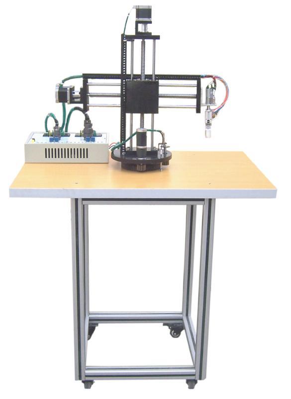 a,机械手实验装置由底座,旋转底座,气动部分,三维(x,y,z)运动机械及电图片