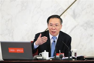 昨日,全国政协十二届四次会议首场新闻发布会上,新任新闻发言人王国庆答记者问。新京报记者 薛�B 摄