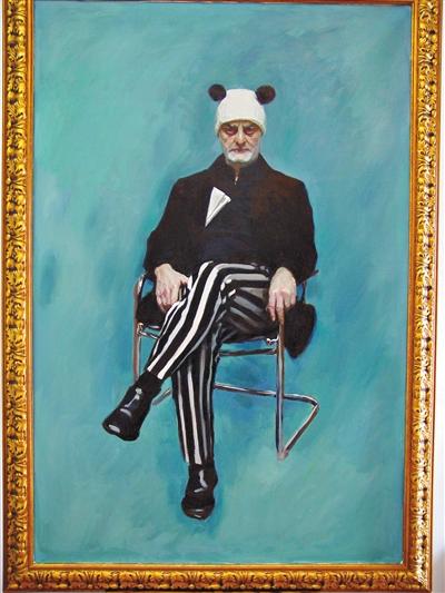 赵半狄创作的乌里·希克肖像,希克头戴一顶熊猫帽子