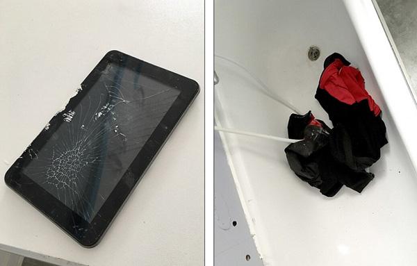 照片中显示恐怖分子留在公寓中的部分用品,包括被损坏的iPad,恐怖分子可能利用它策划布鲁塞尔机场和地铁站袭击行动。此外,公寓浴缸中似乎还有他们留下的衣服。(网页截图)