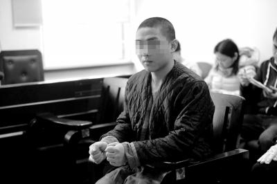 非法入侵电脑的张某受审。京华时报记者谭青摄