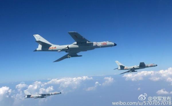 除了对付航母,轰-6K携带巡航导弹射程完全可以攻击关岛,且有核常兼备能力,大规模出动的威慑意义非凡
