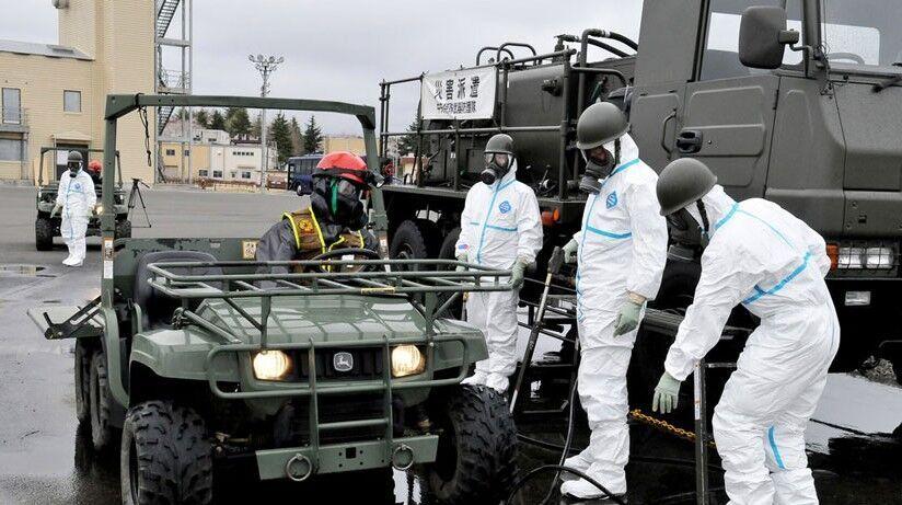 资料图:美国生化部队在日本进行除污演练