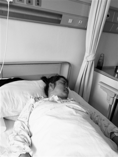 两次手术让张明月极度虚弱。兰州晨报首席记者张学江摄