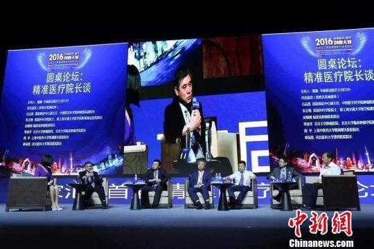 中国科学院院士、复旦大学副校长金力也介绍了其所做从精准医学看人类表型研究。 芊烨 摄