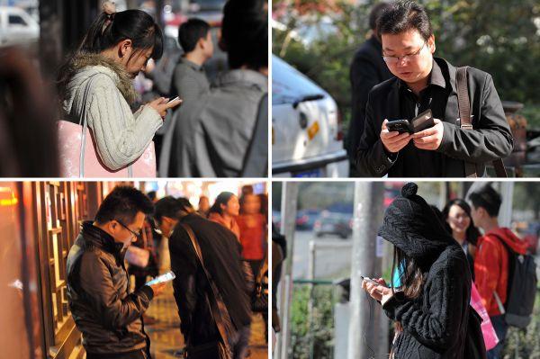 """材料图像:被手机""""绑架""""的""""垂头族""""。新华社记者詹彦摄"""