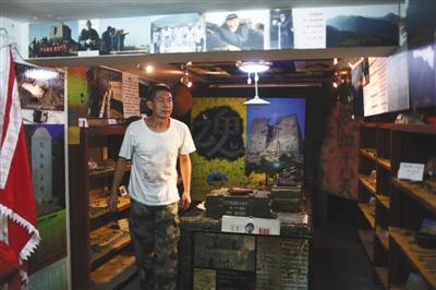 去年8月31日,昌平人杨国庆自费在自家小店地下室搞了一个南口战役纪念馆,收集了上千件抗战文物。新京报记者 浦峰 摄
