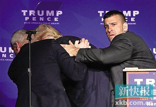 由于演讲中途台下出现骚乱,共和党候选人特朗普紧急被特工带走。
