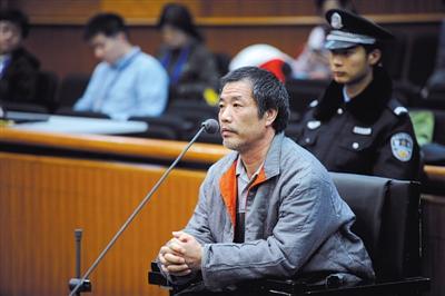 """昨日,被告人吴某在法庭上受审时表示,希望法庭能对他""""公平判决""""。新京报记者 王贵彬 摄"""