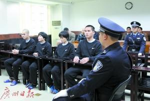 覃某桂等4人当庭认罪。