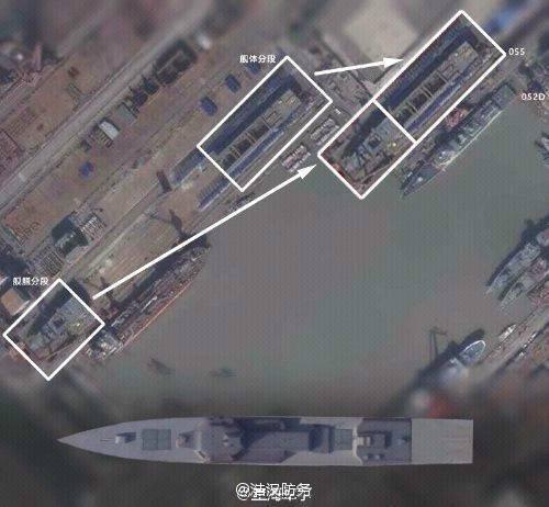 原文配图:卫星照片显示,位于中国上海的江南造船厂正在建造一款超大型驱逐舰,而且这艘驱逐舰的建造进度已经接近100%。