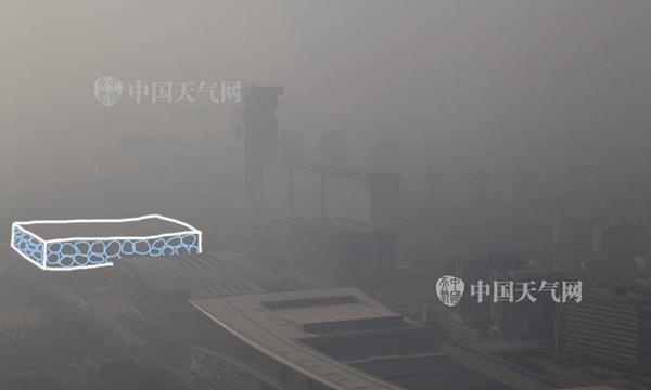 """今天,北京水立方被霾""""淹没""""。关禺摄"""