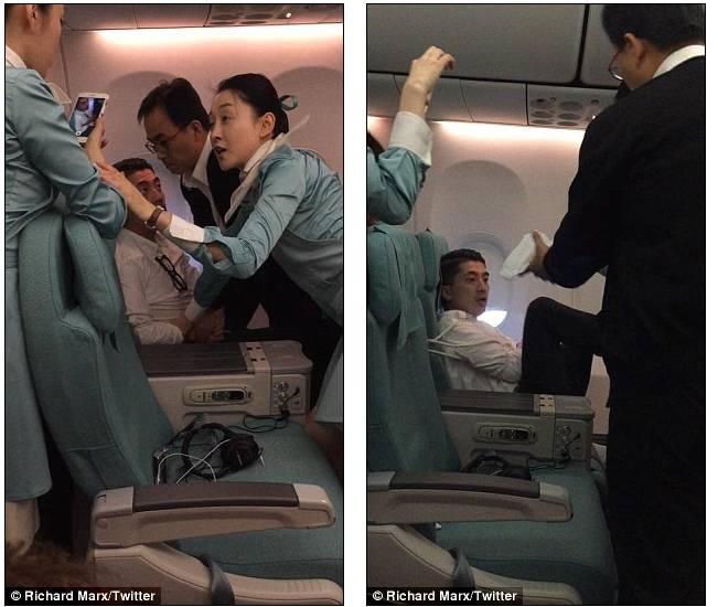 终于,飞机降落在首尔,当地警方赶来将这名男子逮捕。