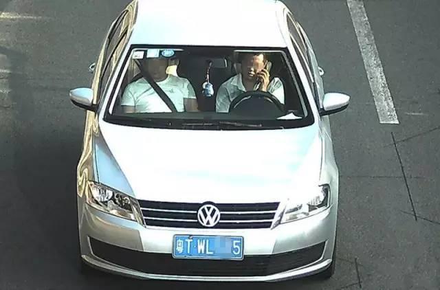 """广州司机对""""电子警察""""做鬼脸比手势 被扣2分"""