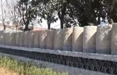 上千老石磙垒出5百米围墙