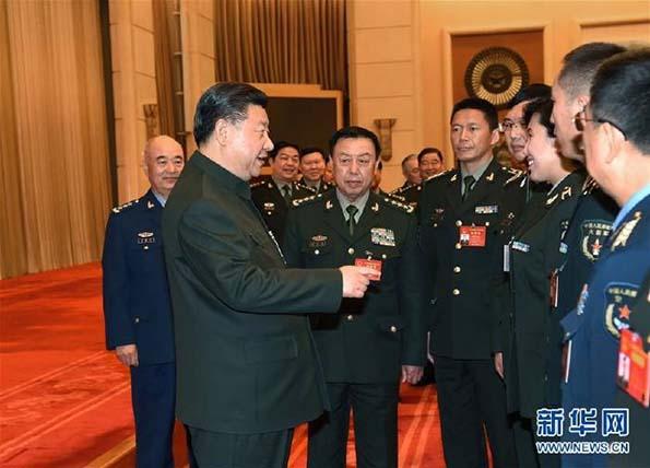 习近平出席解放军代表团全体会议并发表重要讲话。新华社记者 李刚 摄